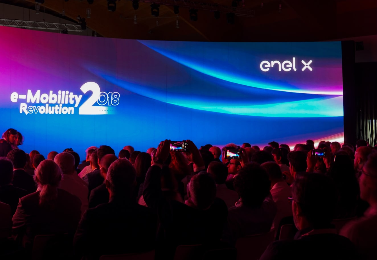 Animated presentation and motion graphics video on the screen at Enel X event - Luther Dsgn